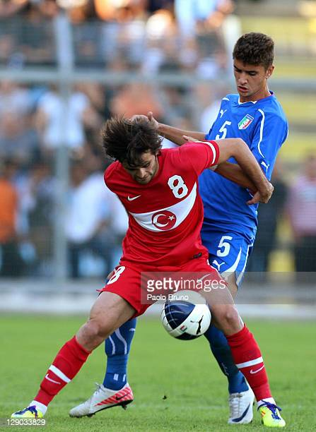 Ale Kucik of Turkey competes for the ball with Luca Antei of Italy during the UEFA European Under-21 Championship qualifying match between Italy and...