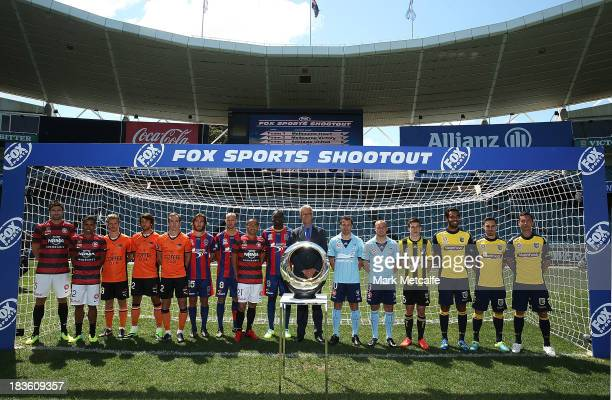 League CEO David Gallop poses with players during the 2013/14 ALeague Season Launch at Allianz Stadium on October 8 2013 in Sydney Australia
