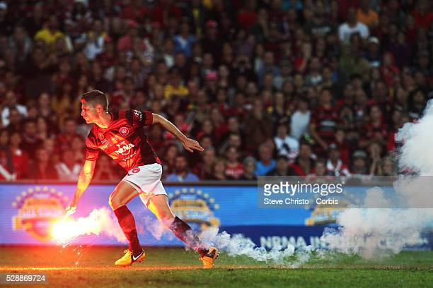 ALeague Grand Final 2013 Western Sydney Wanderers FC v Central Coast Mariners FC at Allianz Stadium The Wanderers Shannon Cole gets rid of a flare...