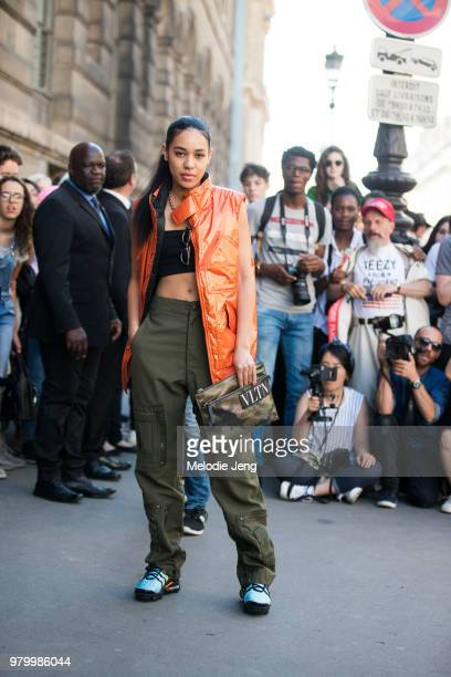 Aleali May at the Valentino show during Paris Fashion Week Men's Spring/Summer 2019 on June 20 2018 in Paris France