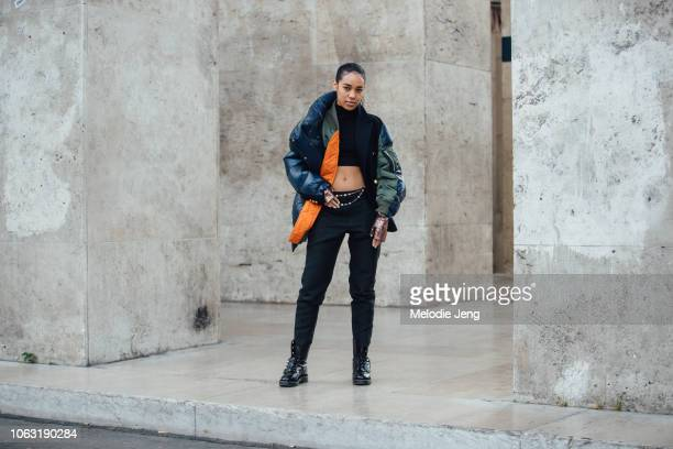 Aleali May attends the Sacai show during Paris Fashion Week Spring/Summer 2019 on October 1 2018 in Paris France