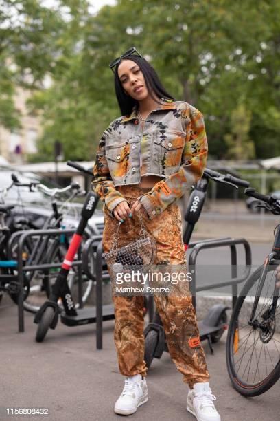 Aleali May is seen on the street attending Men's Paris Fashion Week wearing Heron Preston on June 18 2019 in Paris France
