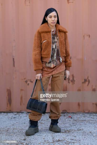 Aleali May is seen on the street during New York Fashion Week AW19 wearing tan fur coat with brown pants and black bag and boots on February 09 2019...