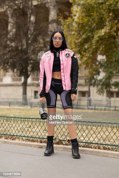 Aleali May is seen on the street during Paris Fashion Week SS19 wearing Chanel on October 2 2018 in Paris France
