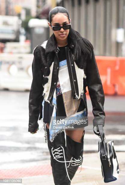 Aleali May is seen wearing a black and white coat and black boots outside the 31 Phillip Lim show during New York Fashion Week Women's S/S 2019 on...