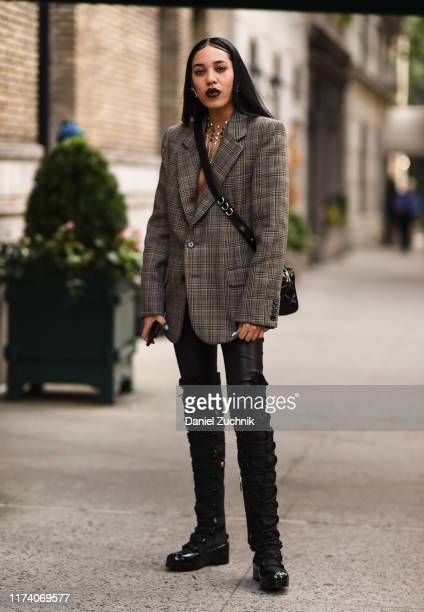 Aleali May is seen wearing a plaid Marc Jacobs jacket and black boots outside the Marc Jacobs show during New York Fashion Week S/S20 on September 11...