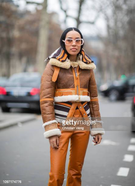 Aleali May is seen wearing cropped shearling jacket orange leather pants sung glasses outside Acne during Paris Fashion Week Menswear F/W 20192020...