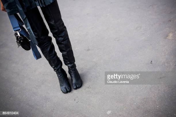 Aleali May Maison Margiela boots details are seen before the Maison Margiela show at the Grand Palais during paris Fashion week Womenswear SS18 on...