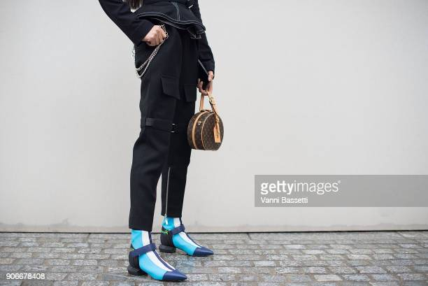 Aleali May poses wearing Louis Vuitton after the Louis Vuitton show at Place Colette during Paris Fashion week Menswear FW18/19 on January 18 2018 in...
