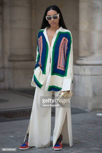 Aleali May poses wearing Louis Vuitton and Nike shoes after the Louis Vuitton show at the Jardins du Palais Royal during Paris Fashion Week Menswear...