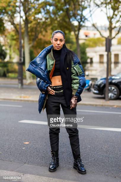 Aleali May wearing a black top black trousers black boots and a fancy jacket is seen after the Sacai show on October 1 2018 in Paris France
