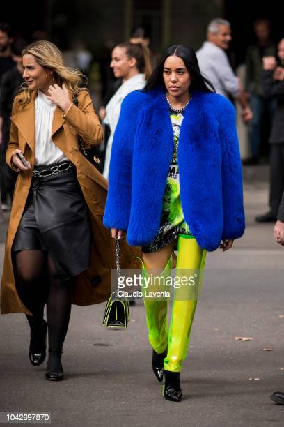 Aleali May wearing a electric blue fur black and neon green seethrough boots and Balmain bag is seen after the Balmain show on September 28 2018 in...