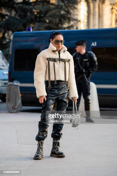 Aleali May wearing a fur jacket black leather pants black boots and see through bag is seen in the streets of Paris before the Sacai show on January...