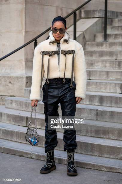 Aleali May wearing a fur jacket black leather pants black boots and see through bag is seen in the streets of Paris after the Sacai show on January...