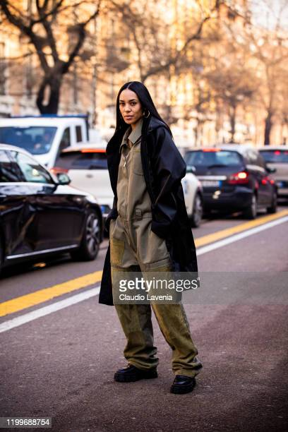 Aleali May, wearing a khaki green jumpsuit, black coat and black shoes, is seen outside the Fendi show during the Milan Men's Fashion Week on January...
