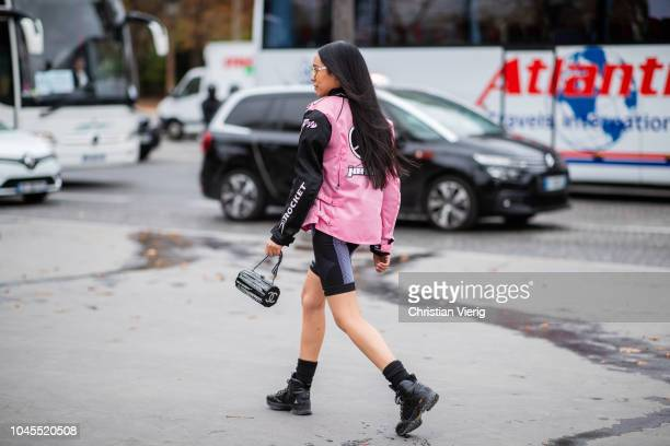 Aleali May wearing Misbhv cycle pants pink jacket cropped top is seen outside Chanel during Paris Fashion Week Womenswear Spring/Summer 2019 on...