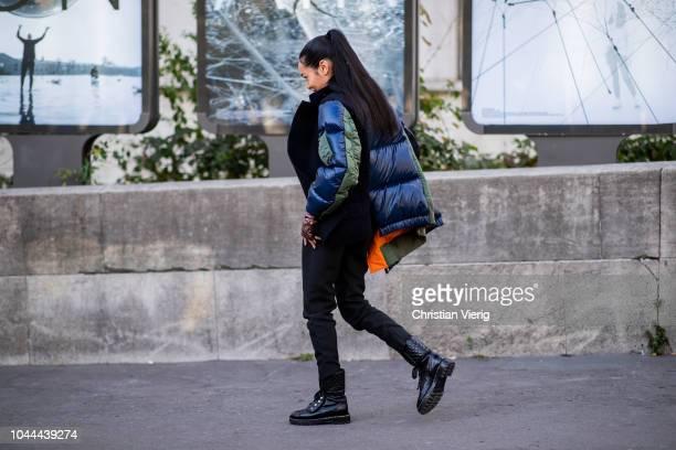 Aleali May wearing puffer jacket is seen outside Sacai during Paris Fashion Week Womenswear Spring/Summer 2019 on October 1 2018 in Paris France