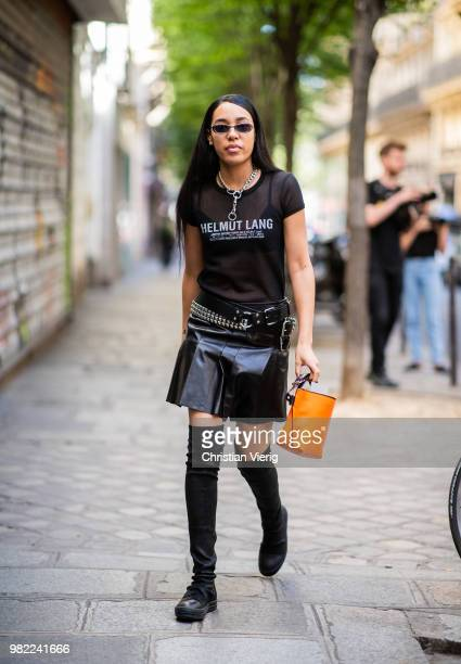 Aleali May wearing sheer Helmut Lang top black mini skirt overknee boots is seen on day five of Paris Fashion Week Menswear SS19 on June 23 2018 in...