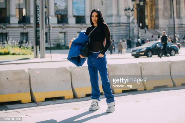 Aleali May wears a black top blue pants and chunky sneakers after the Margiela show during Paris Fashion Week Spring/Summer 2019 on September 26 2018...