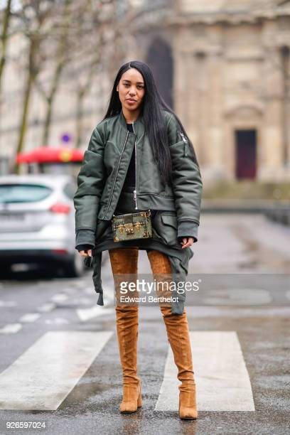 Aleali may wears a green bomber jacket brown thigh high boots a Vuitton rigid bag outside Balmain during Paris Fashion Week Womenswear Fall/Winter...
