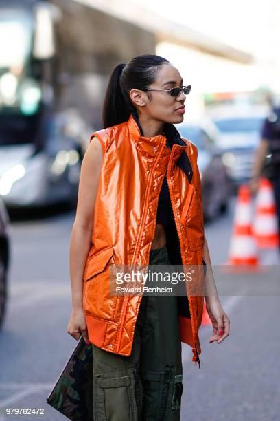 Aleali May wears an orange vest green pants cropped bare belly top outside Valentino during Paris Fashion Week Menswear SpringSummer 2019 on June 20...
