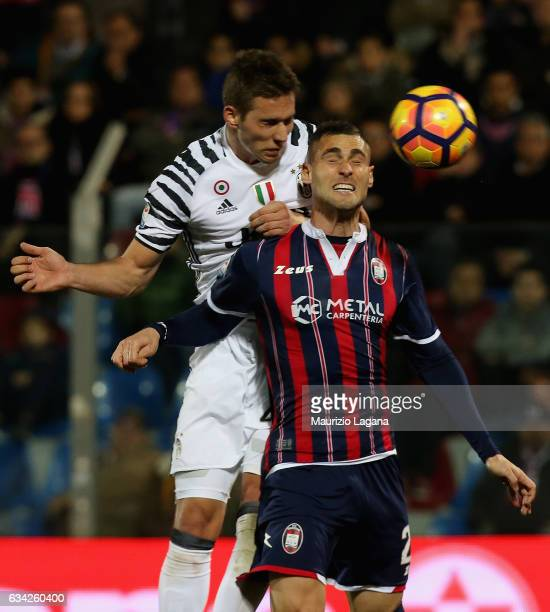 Aleandro Rosi of Crotone competes for the ball in air with Marko Pjaca of Juventus during the Serie A match between FC Crotone and Juventus FC at...