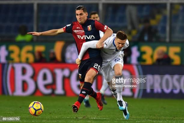 Aleandro Rosi of Genoa CFC is challenged by Josip Ilicic of Atalanta BC during the Serie A match between Genoa CFC and Atalanta BC at Stadio Luigi...