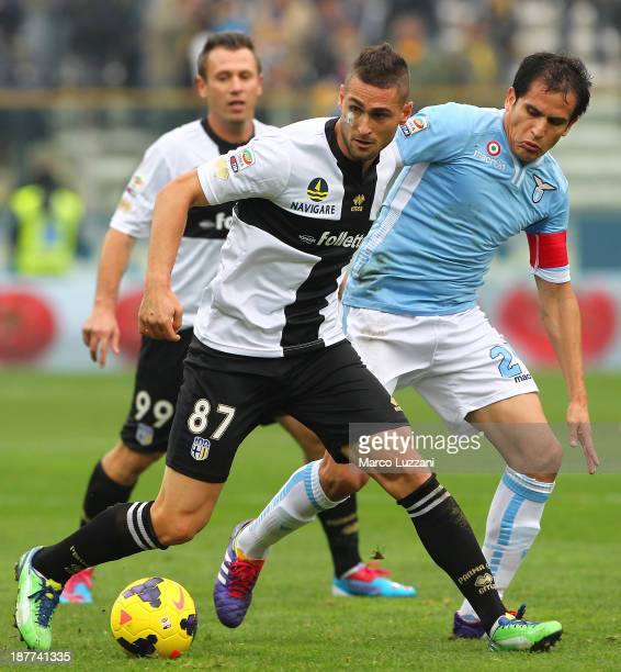 Aleandro Rosi of Parma FC competes for the ball with Cristian Ledesma of SS Lazio during the Serie A match between Parma FC and SS Lazio at Stadio...