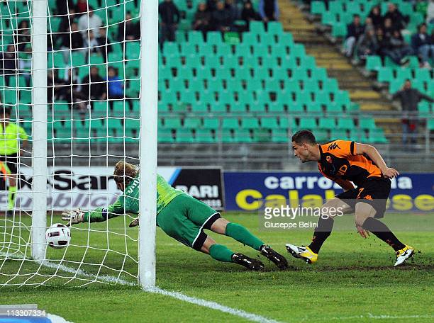 Aleandro Rosi of Roma scores their third goal during the Serie A match between AS Bari and AS Roma at Stadio San Nicola on May 1 2011 in Bari Italy