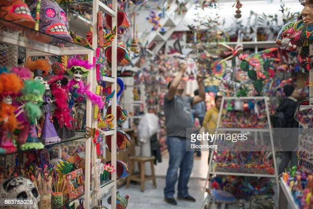 Alebrijes Mexican folk art sculptures sit on display for sale at the Ciudadela Market in Mexico City Mexico on Tuesday Oct 17 2017 The first...