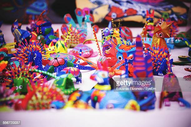 alebrijes of various animals on floor - alebrije stock pictures, royalty-free photos & images