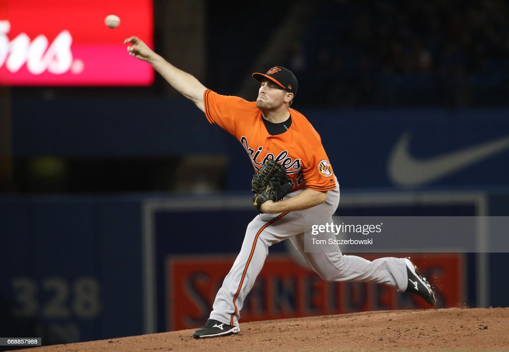 Alec Asher #49 of the Baltimore Orioles delivers a pitch in the first inning during MLB game action against the Toronto Blue Jays at Rogers Centre on April 15, 2017 in Toronto, Canada. All players are wearing #42 in honor of Jackie Robinson Day.