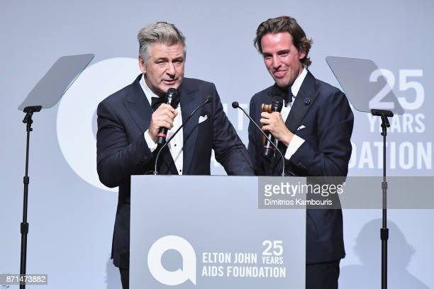 Alec Baldwin and Alexander Gilkes speak onstage at the Elton John AIDS Foundation Commemorates Its 25th Year And Honors Founder Sir Elton John During...