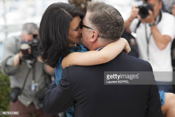Alec Baldwin and Hilaria Baldwin attend the photocall for 'Seduced and Abandoned' during The 66th Annual Cannes Film Festival at Palais des Festivals...
