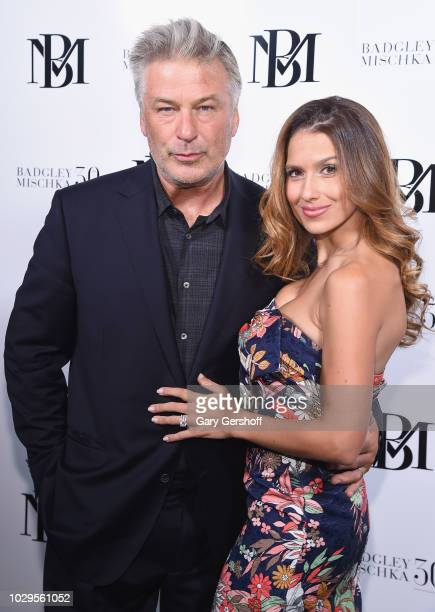 Alec Baldwin and Hilaria Baldwin pose backstage at the BadgleyMischka Fashion Show during New York Fashion Week at Gallery I at Spring Studios on...