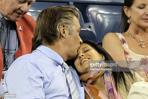 Alec Baldwin and Hilaria Thomas attend the match between Roger Federer of Switzerland and Santiago Giraldo of Colombia during Day One of the 2011 US...