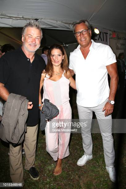 Alec Baldwin Hilaria Baldwin and Peter Cook attend the 14th Annual Author's Night to benefit the East Hampton Library on August 11 2018 in East...