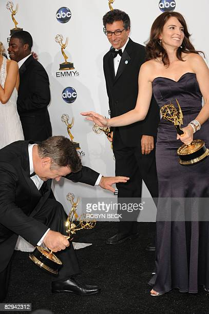 "Alec Baldwin jokingly bows to Tina Fey while holding their Emmys for outstanding lead actress and actor in a comedy series for ""30 Rock"" in the press..."