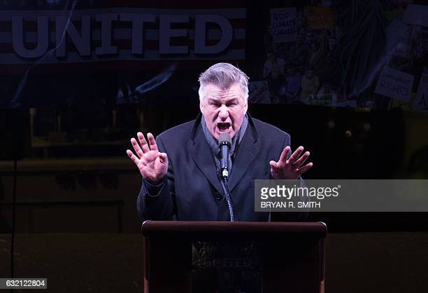 Alec Baldwin speaks at the We Stand United rally on the eve of US Presidentelect Donald Trump's inauguration outside Trump International Hotel and...