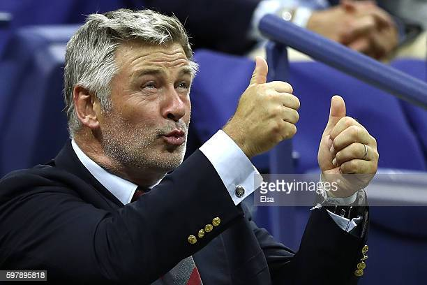 Alec Baldwin watches the first round Men's Singles match between Novak Djokovic of Serbia Montenegro and Jerzy Janowicz of Poland on Day One of the...