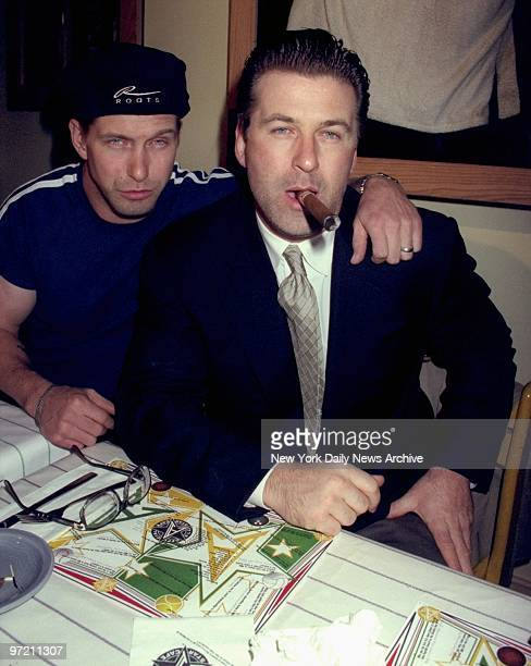 Alec Baldwin with cigar and brother Stephen Baldwin attending Evander HolyfieldMichael Moorer fight at the All Star Cafe