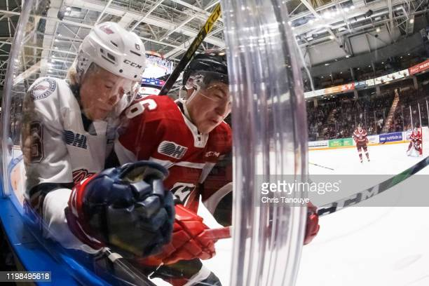 Alec Belanger of the Ottawa 67's bodychecks Dawson Mckinney of the Oshawa Generals during an OHL game at the Tribute Communities Centre on December...