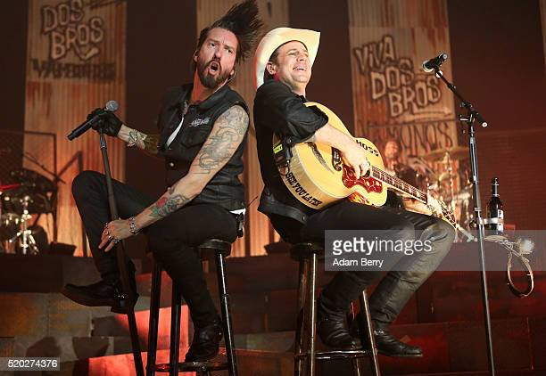 Alec 'Boss Burns' Voelkel and Sascha 'Hoss Power' Vollmer of The Boss Hoss perform during a concert at MaxSchmelingHalle on April 10 2016 in Berlin...