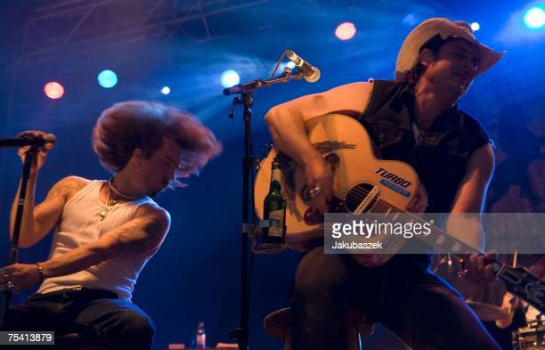 Alec 'Boss Burns' Voelkel and Sascha 'Hoss Powers' Vollmer of the German band The BossHoss perform during a concert at the Zitadelle Spandau July 14...