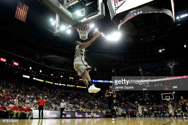 Alec Burks of the Colorado Buffaloes dunks the ball in the first half against the Texas Tech Red Raiders during the first round game of the 2010...