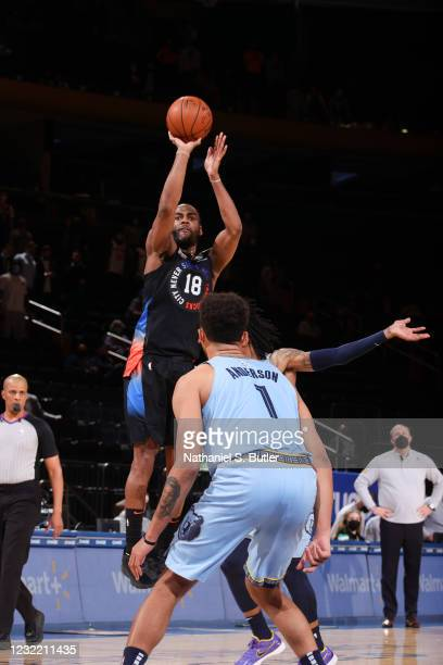 Alec Burks of the New York Knicks shoots a three pointer during the game against the Memphis Grizzlies on April 9, 2021 at Madison Square Garden in...