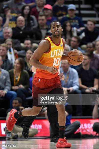 Alec Burks of the Utah Jazz brings the ball up court during the first half of a game against the Golden State Warriors at Vivint Smart Home Arena on...