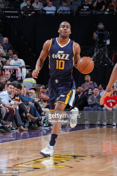 Alec Burks of the Utah Jazz brings the ball up the court against the Sacramento Kings on March 29 2017 at Golden 1 Center in Sacramento California...