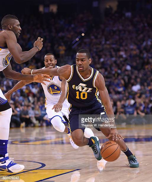 Alec Burks of the Utah Jazz dribbles the ball against the Golden State Warriors during their NBA basketball game at ORACLE Arena on December 23 2015...