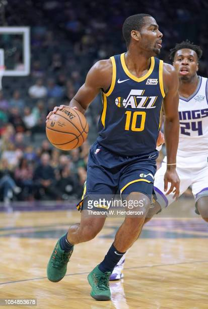 Alec Burks of the Utah Jazz dribbles the ball against the Sacramento Kings during the first half of their NBA basketball game at Golden 1 Center on...